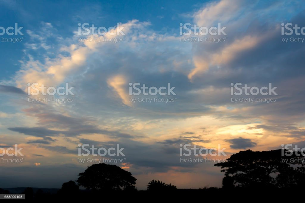 Sunset with partly cloudy sky. Dramatic sky royalty-free 스톡 사진