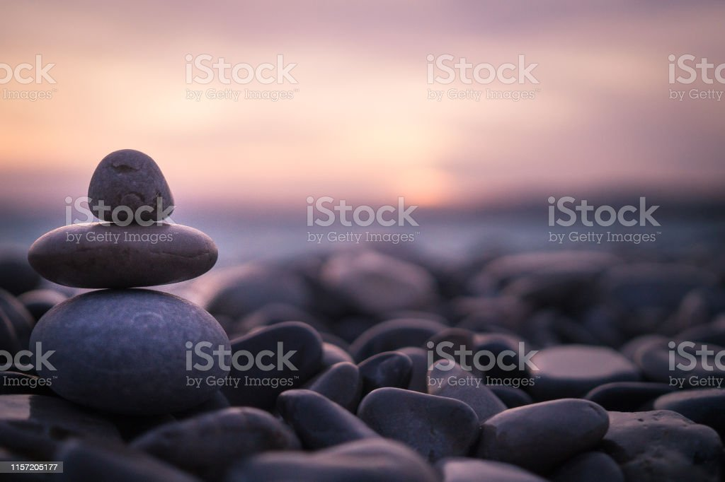 Sunset with pebbles on beach in Nice, France. - Foto stock royalty-free di Acqua