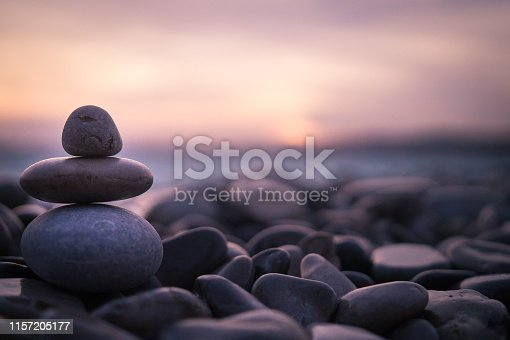 Sunset on pebbles in Nice, France.