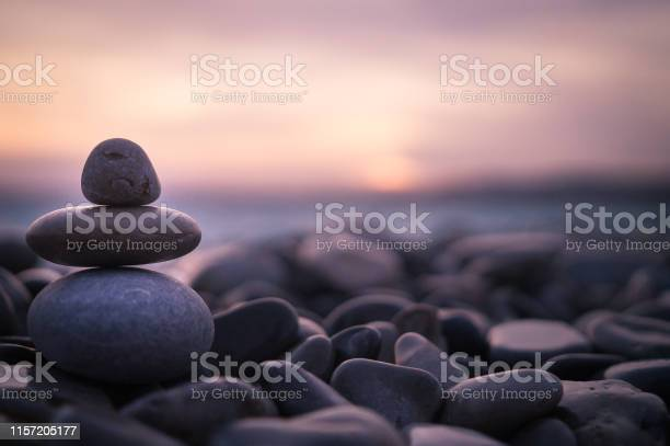 Photo of Sunset with pebbles on beach in Nice, France.