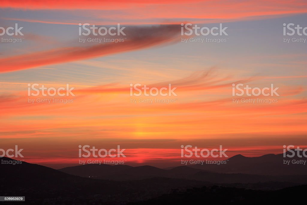 Sunset with pink clouds stock photo