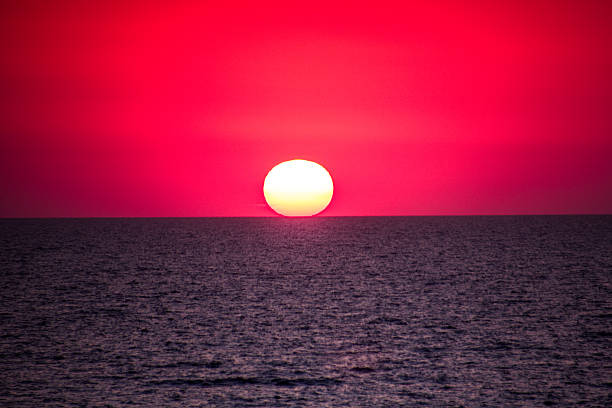 Sunset with red sky and sea water stock photo