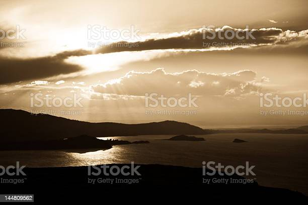 Sunset with reflection on the lake Titicaca