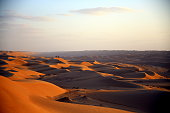 Sunset with spectators on the dunes of the Omani desert, Wahiba Sands / Sharqiya Sands, Oman