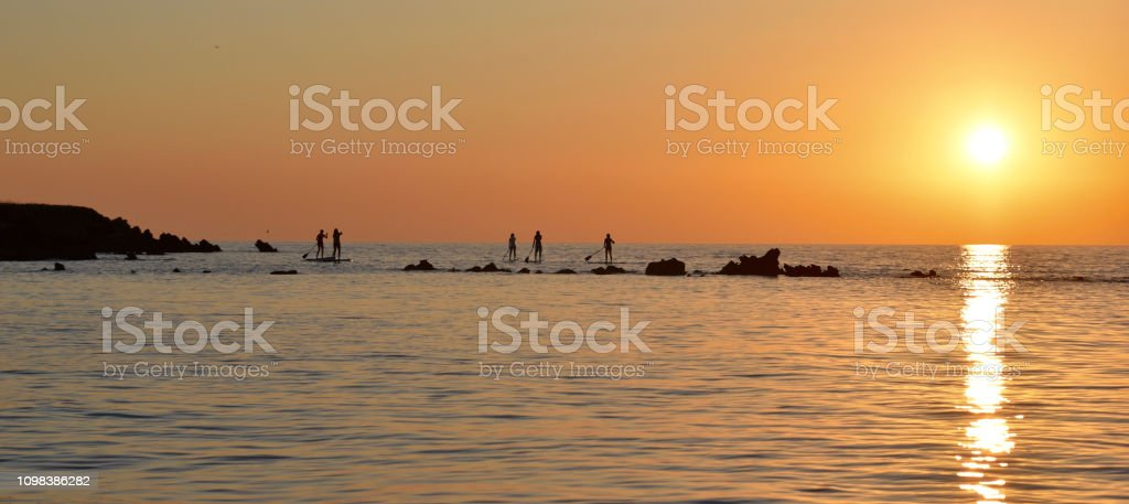 Sunset with Standup-Paddlers stock photo