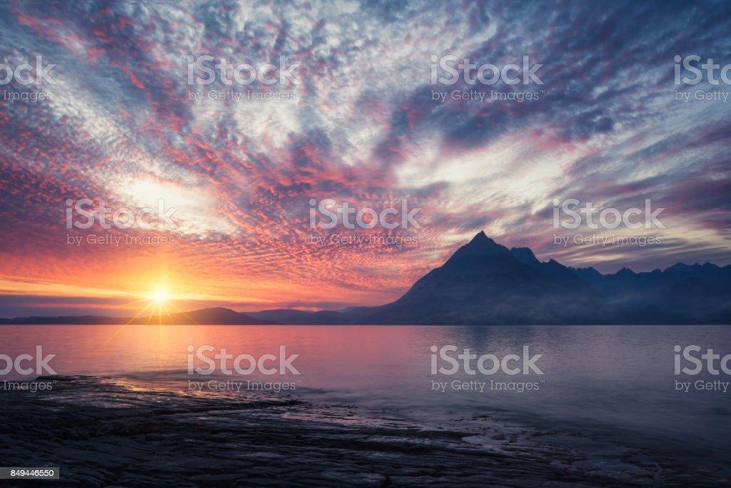 Sunset with starbursts at Elgol, Isle of Skye, Scotland, UK. stock photo