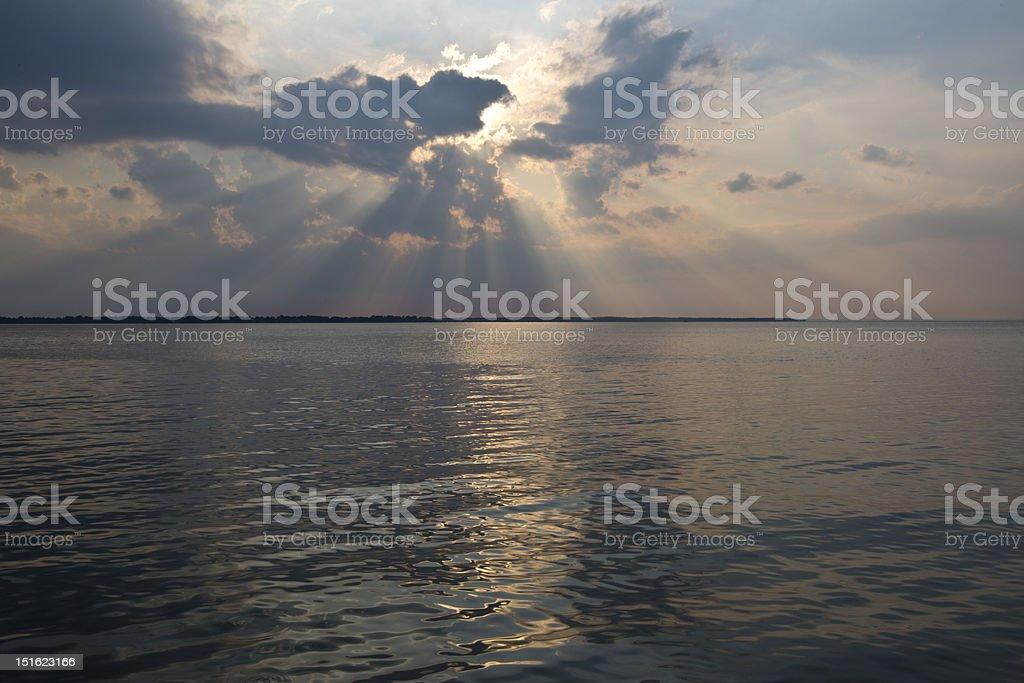 Sunset with sun beams stock photo