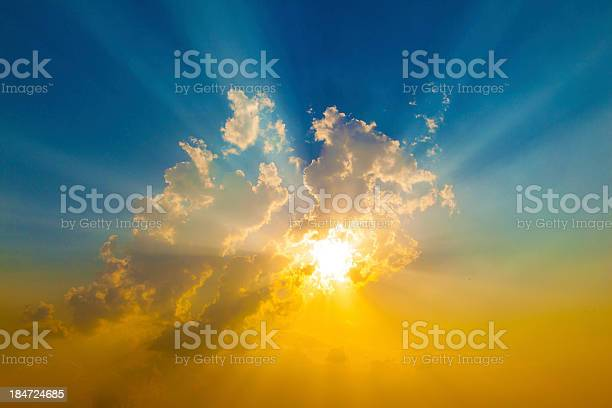 Photo of Sunset with sun rays coming through clouds