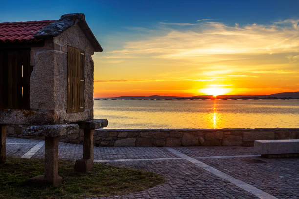 Sunset with traditional barn in Galicia stock photo