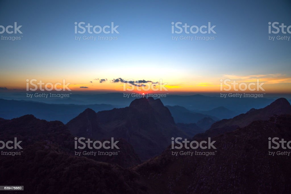Sunset with wide screen and big mountains stock photo