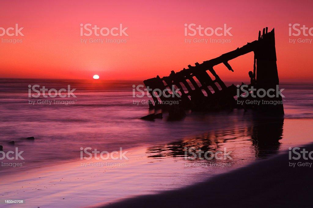 sunset wreck stock photo
