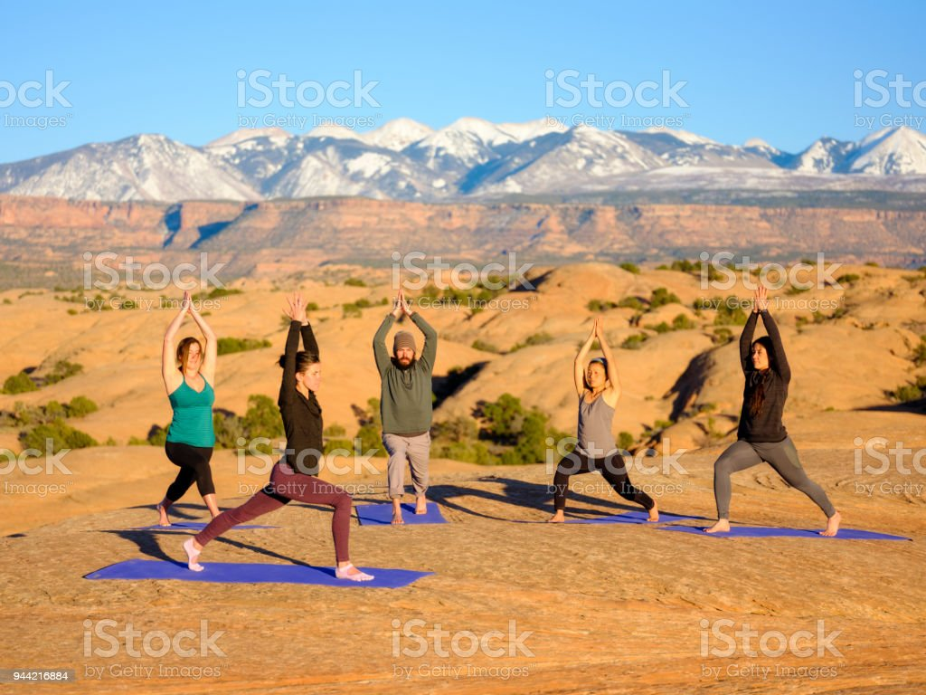 Sunset Yoga in Moab Utah stock photo