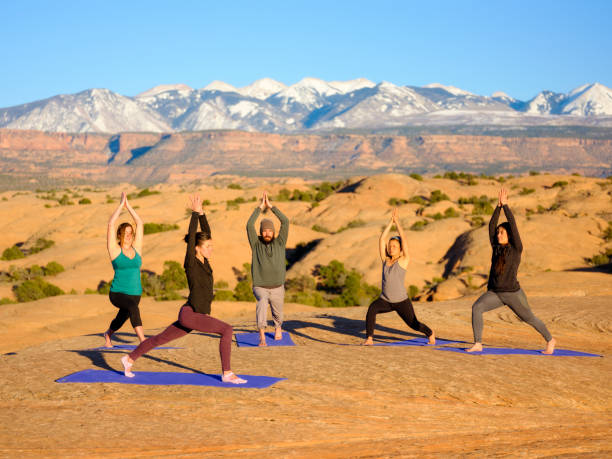 sunset yoga in moab utah - image stock pictures, royalty-free photos & images