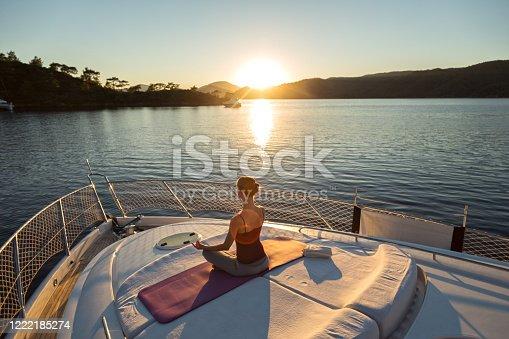 Sunset Yoga on the Yacht. Meditation and Yoga Practicing at Sunset