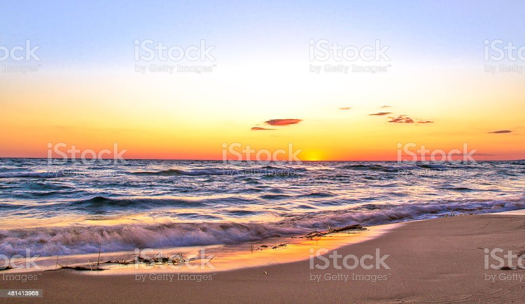 Sunsets Over A Wide Sandy Beach In Paradise stock photo