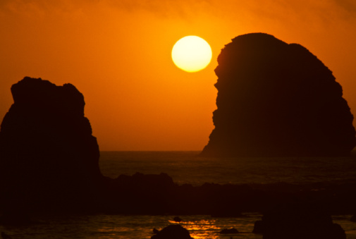 Sunset Over The Pacific Ocean With Rock Stacks Stock Photo - Download Image Now