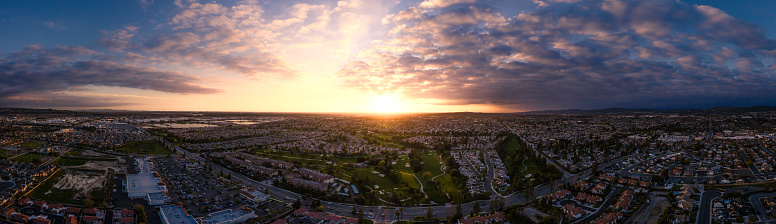 Aeiral pano capture from an altitude of 100 meters over a golf course and housing complex in California. Image captured at sunset.