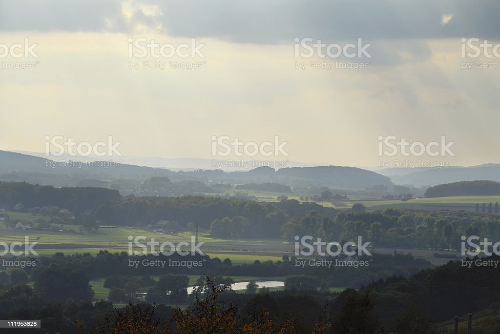sunshine and rain on the vally of the river Ruhr near Froendenberg,...
