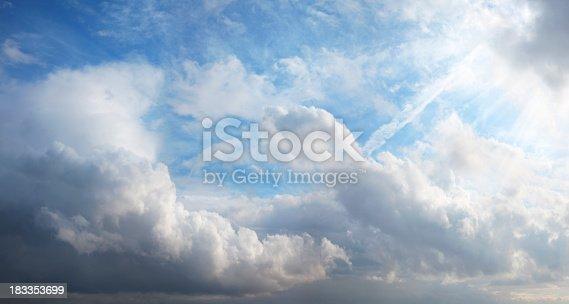 157673091istockphoto sunshine behind clouds 183353699