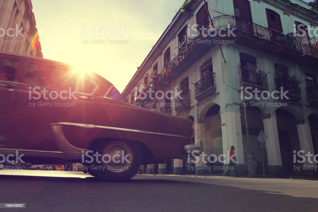 Sunshine, Buildings and Antique car in Havana, Cuba royalty-free stock photo
