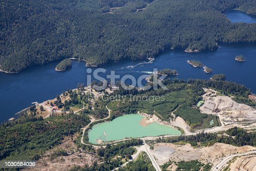 Aerial view of mining industry near Sechelt Inlet during a vibrant sunny day. Located in Sunshine Coast, BC, Canada.