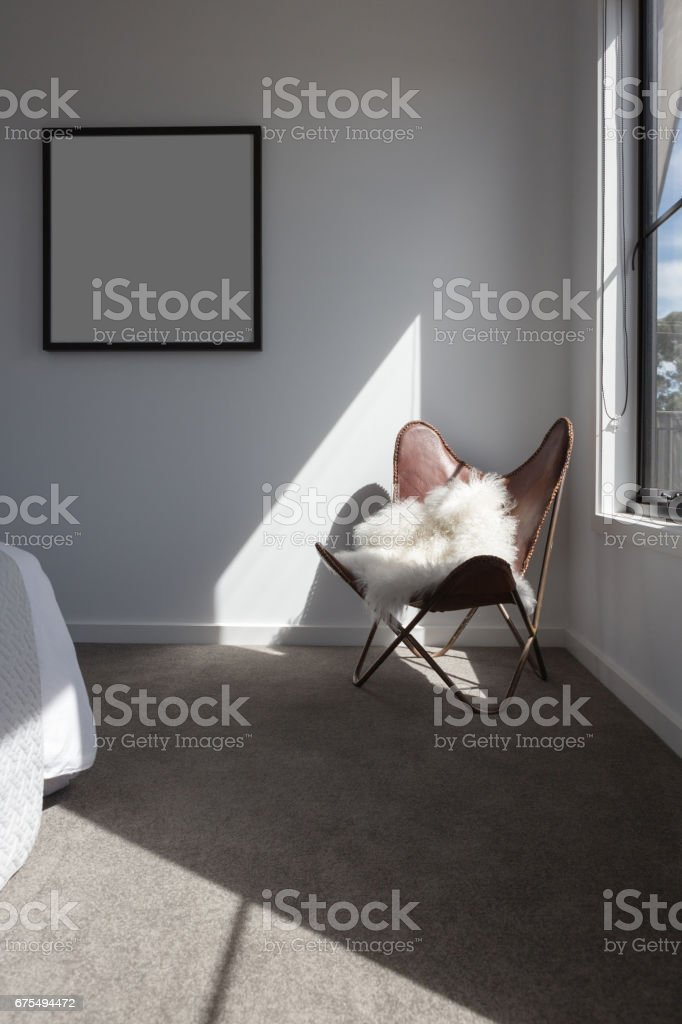Sunshine highlight on a leather chair in a master bedroom stock photo