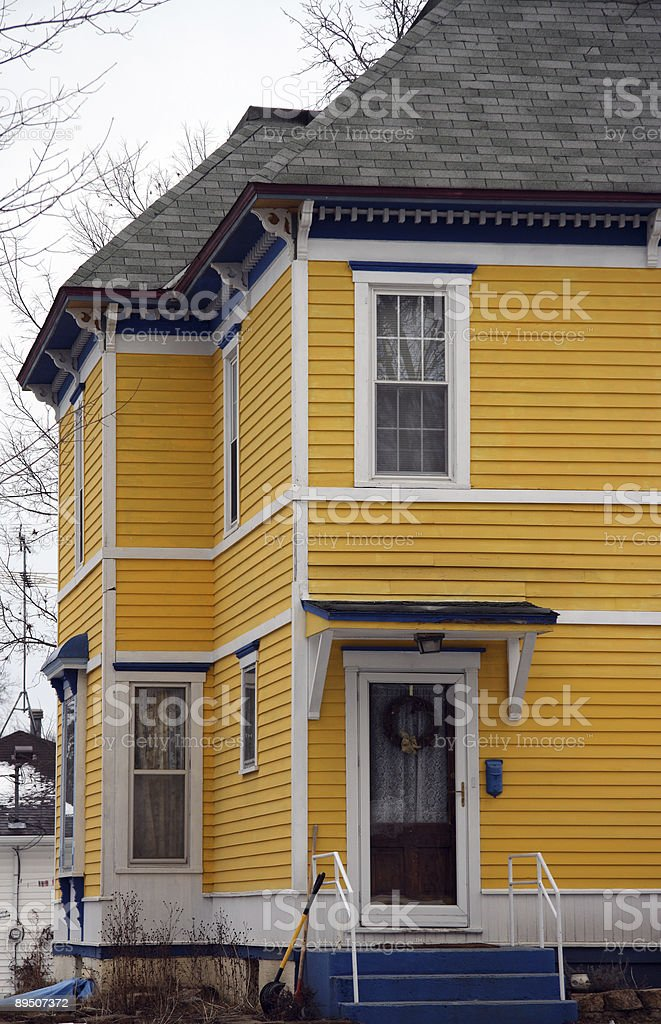 Sunshine house on a gray day. royalty-free stock photo