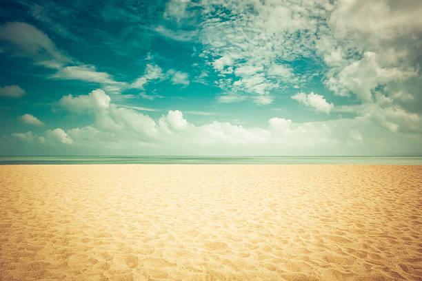 Sunshine on empty beach stock photo