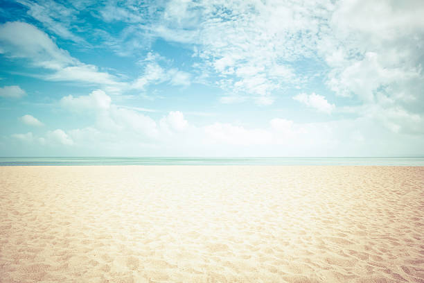 sunshine on empty beach - vintage look - beach stock pictures, royalty-free photos & images