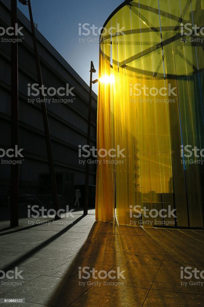 sunshine rays through yellow plastic drapes public sitting area stock photo