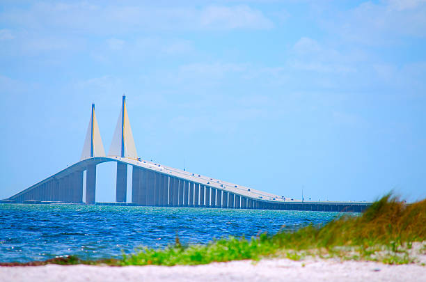 sunshine skyway bridge with beach tampa bay florida usa - walkway and bridge stock photos and pictures