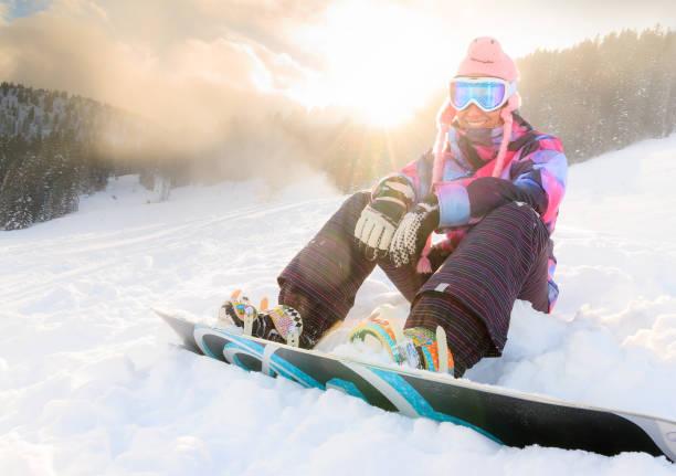 Sunshine snowboard woman stock photo