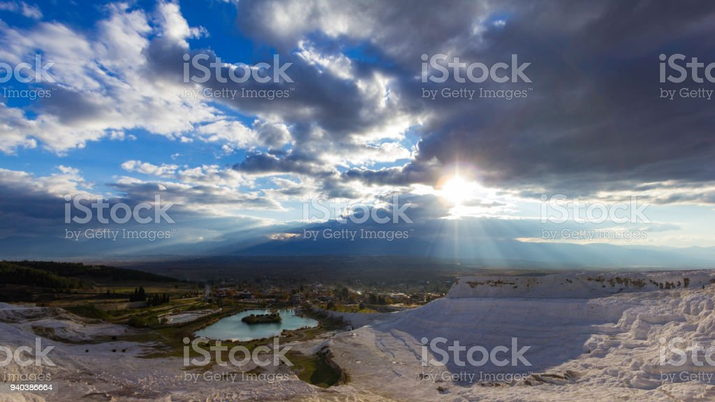Sunshine through the clouds stock photo
