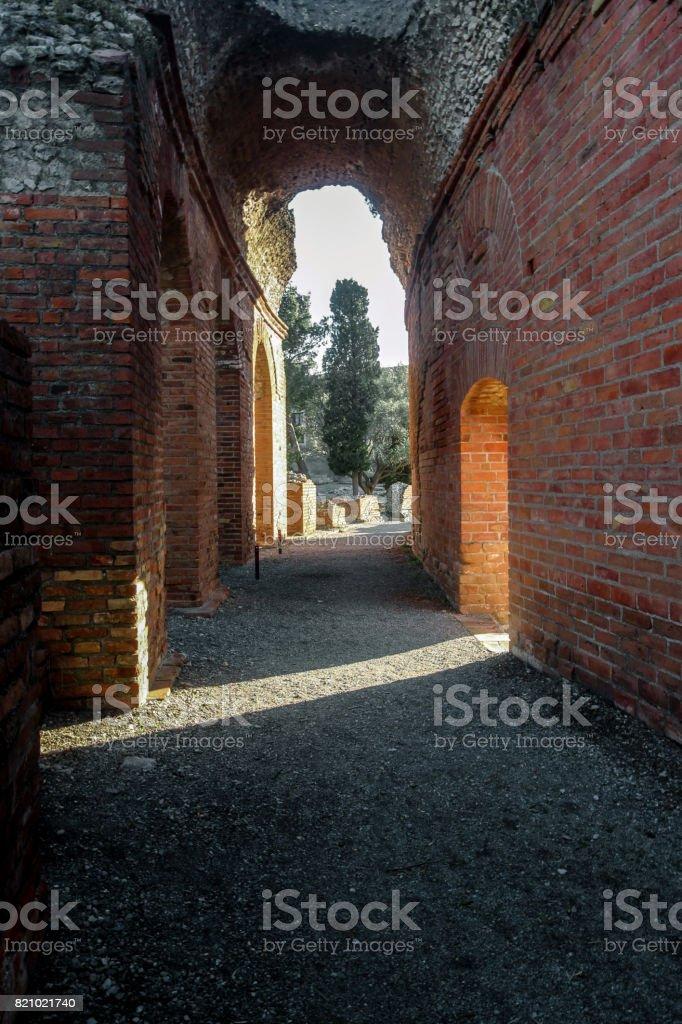 sunshine through the gate in greek theater in Taormina stock photo