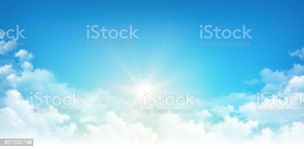 Photo of Sunshine through white clouds