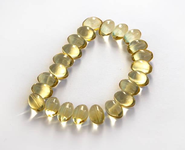 sunshine vitamin d symbol - vitamin d stok fotoğraflar ve resimler