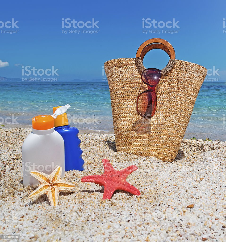 suntan lotion and straw bag royalty-free stock photo
