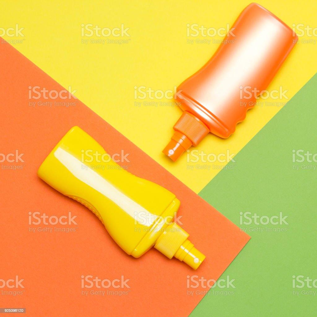 Suntan lotions on multi-colored blocks stock photo