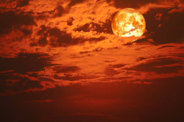 super blood snow moon back on silhouette cloud on sunset sky stock photo