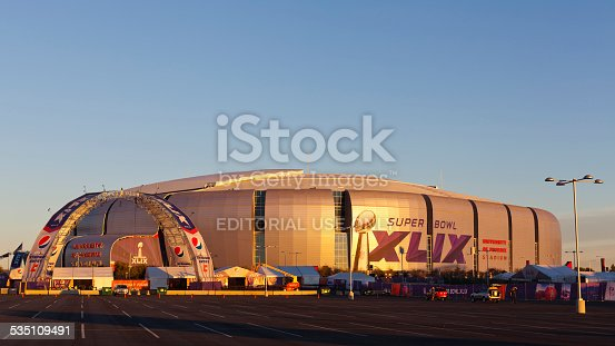 Glendale, US – January 24, 2015: Evening cast golden color on silver dome of University of Phoenix Arizona Cardinal Stadium that dressed up for Super Bowl XLIX taking place on  February 1, 2015