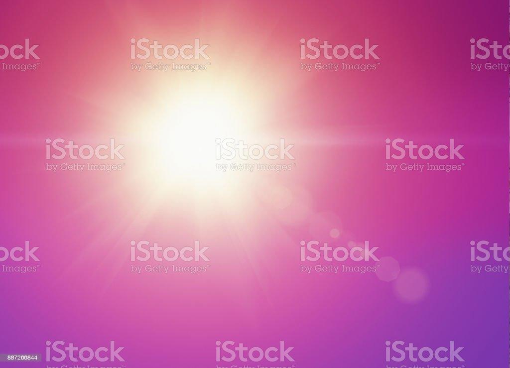 Super bright sun in magenta sky stock photo