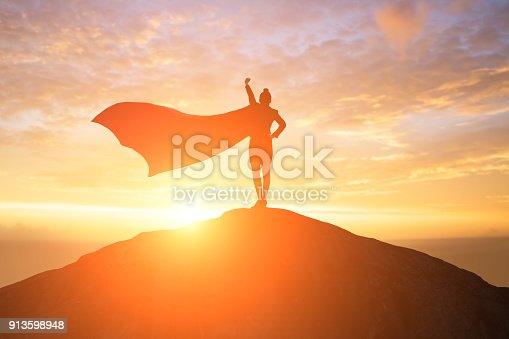 istock super business woman on mountain 913598948