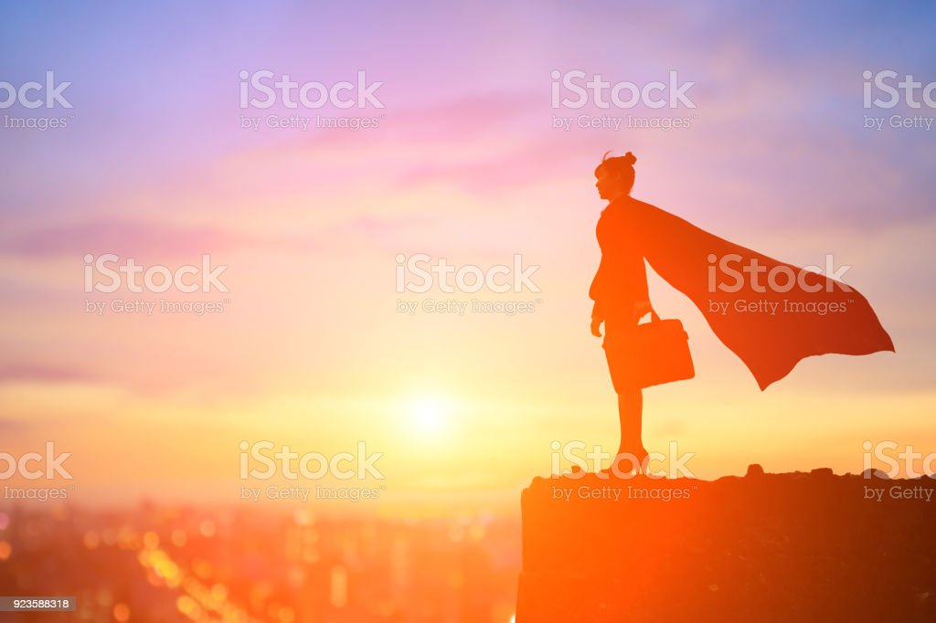 super business woman on mountain stock photo