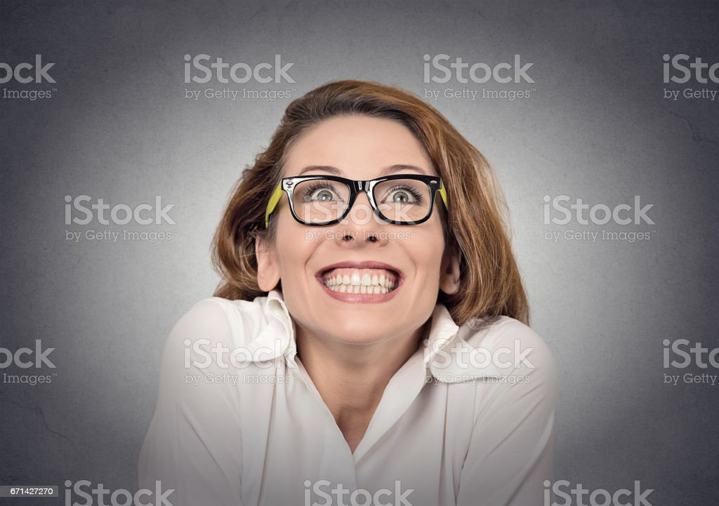 super excited funky girl looking up on grey wall background stock photo