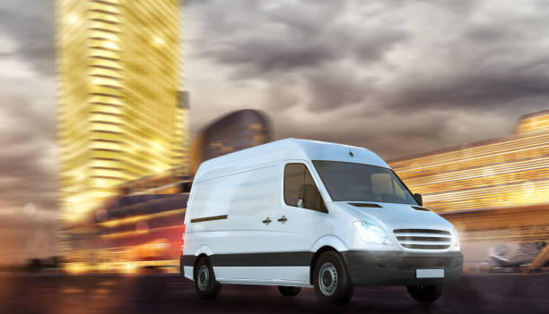 Super fast delivery of package service with a moving van on modern cityscape stock photo