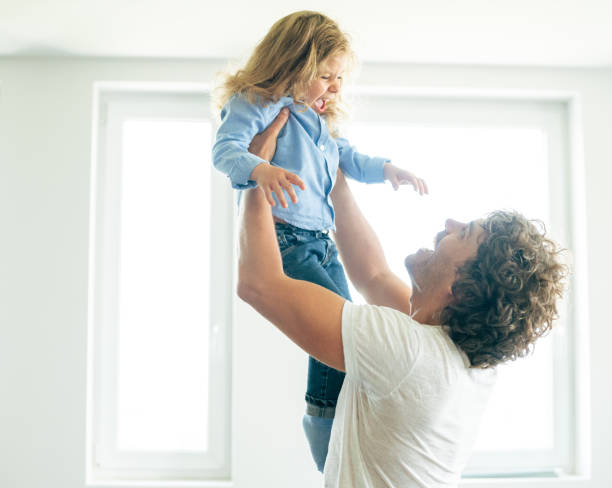 super fathers raise super children - violetastoimenova stock photos and pictures