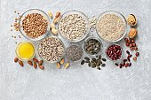 Super food dried ingredients group included quinoa, chia seeds, sesame, lentils, sunflofer and pumpkin seeds, red beans and nuts.