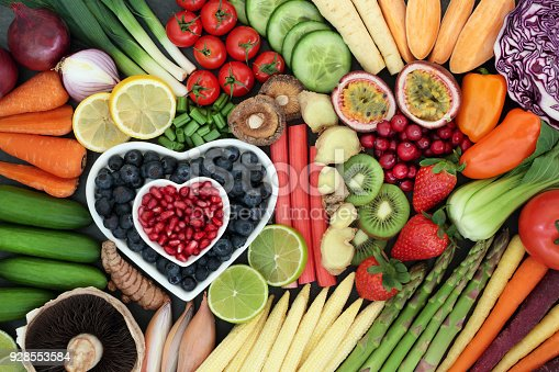 Super food for healthy eating concept with fresh fruit and vegetables forming an abstract background. Health food high in anthocyanins, antioxidants, vitamins, minerals and dietary fibre.