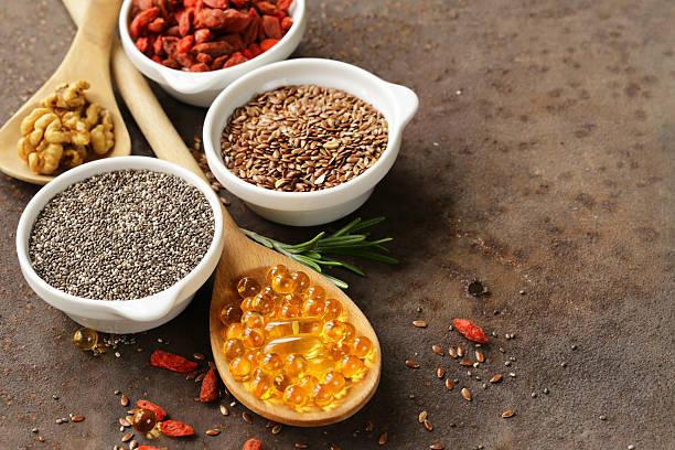 super food - goji berries, chia seeds, flax seeds, walnuts - vitamin d stok fotoğraflar ve resimler