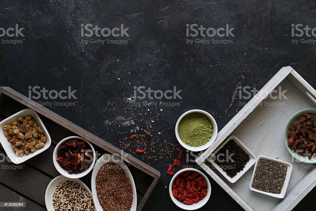 Super Food in bowls on dark ground stock photo